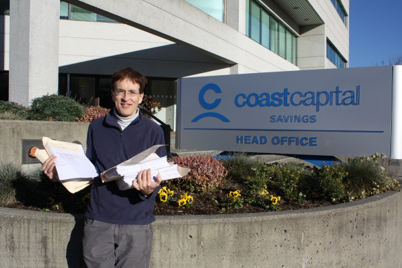 Mark Latham has worked with us to help Restore Member Control to Coast Capital. Here he is helping us deliver our Special Resolution Signed Petitions to Coast Capital Headquarters last year.